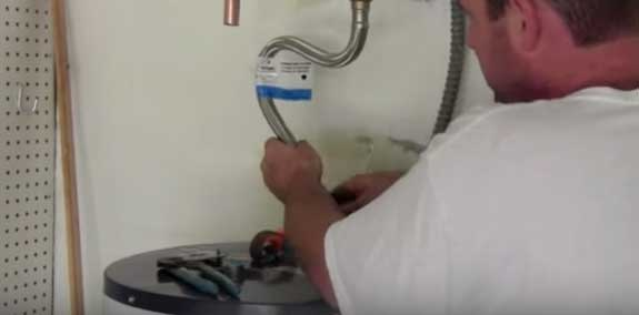 Installing the supply lines to an electric water heater