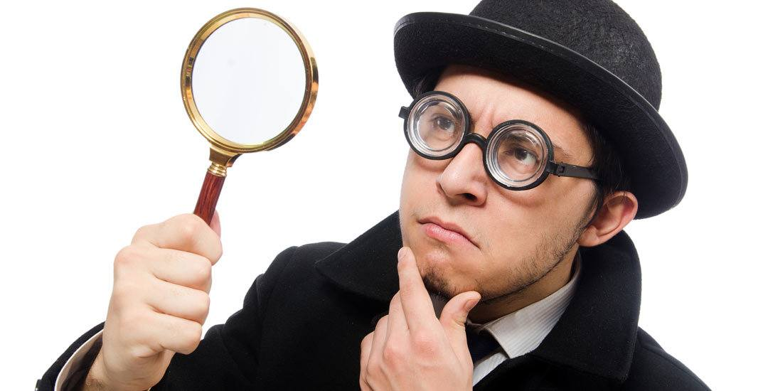 Man wearing glasses with magnifying glass