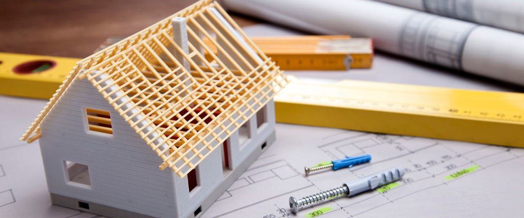 Toothpick house on blueprints