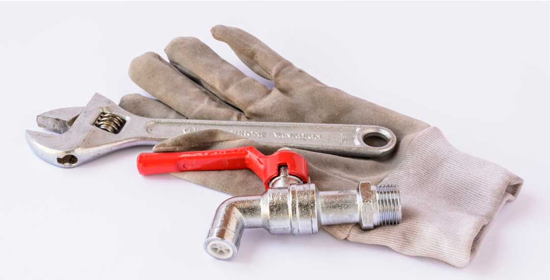 Glove with wrench and drain valve