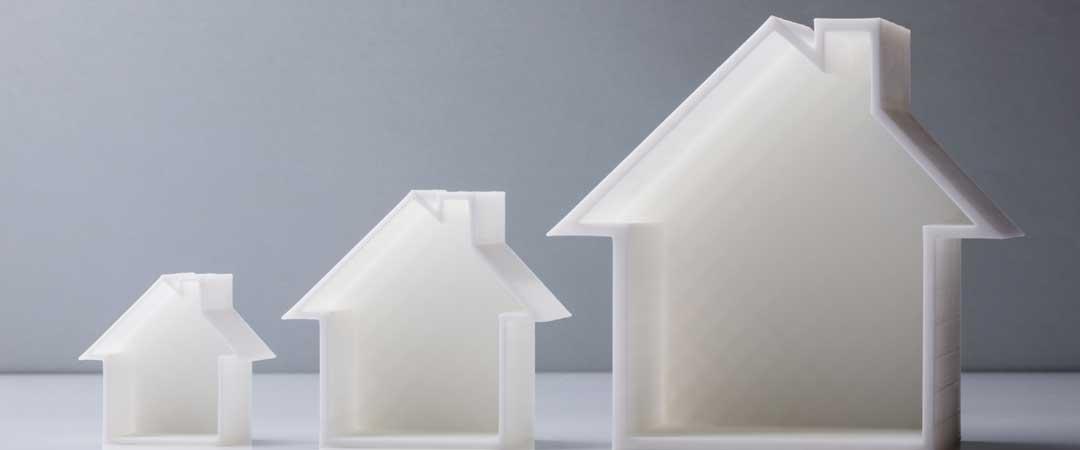 Three sizes of plastic houses