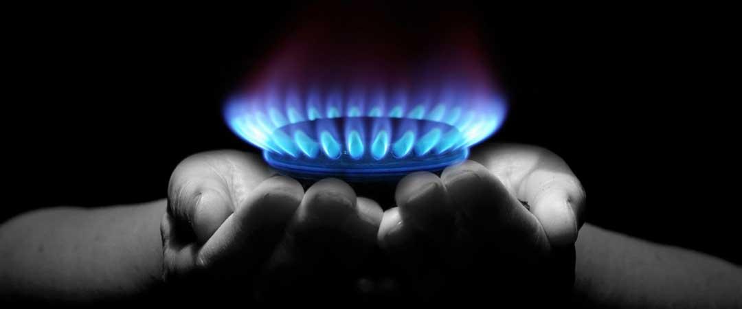 Hands holding a gas burner